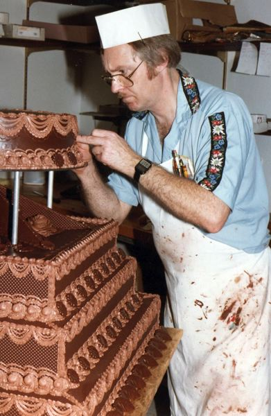 by: CONTRIBUTED PHOTO: ELMER FAMILY - Elmer decorating a cake in the mid-1980s at Heidis, on Highway 26 midway between Gresham and Sandy.