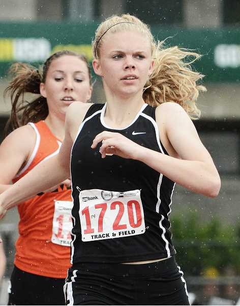 by: JOHN WILLIAM HOWARD - Tribe senior Charlie Davidson beat out Emily Bever of Molalla for the top seed in the 4A girls 800 meter finals. She'll look for a state title in two events on Saturday, the 800 and 1500 meter races.