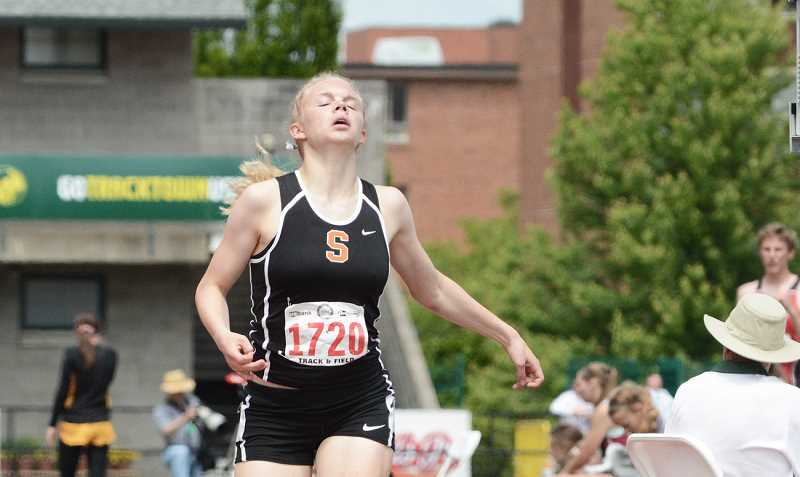 by: JOHN WILLIAM HOWARD - Scappoose senior Charlie Davidson reacts after finishing first in the state finals for the 4A Girls' 1500 meter run.