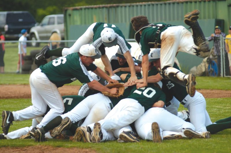 by: ESTACADA NEWS: PARKER LEE - Estacada players dog pile on the mound after last weeks 6-5 play-in qualifier win over Sweet Home.