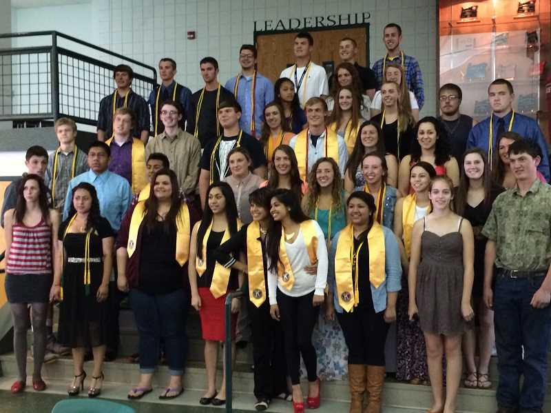 by: LINDSAY KEEFER - North Marion High School seniors gathered for a group photo May 21 after receiving scholarships and recognition.