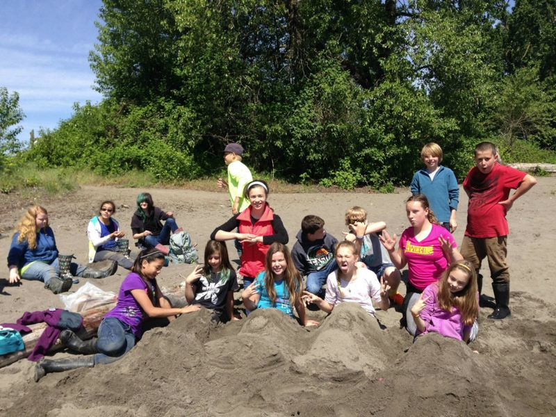 by: PHOTO COURTESY OF ALY FERRIS - Sauvie Island Academy students celebrate a year of wetland restoration at Ruby Lake on their first sunny field day since February.