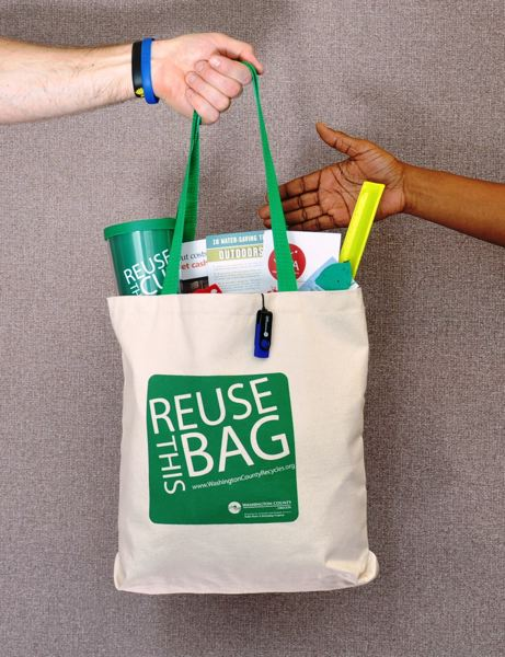by: SUBMITTED PHOTO - Businesses that request a free workplace recycling evaluation will receive a Green Team Kit containing reusable bags, durable drink tumblers, a thumb-drive stocked with educational materials, as well as informational resources from program partners.