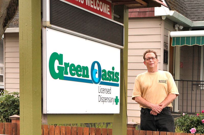 by: DAVID F. ASHTON - At the door of the Sellwood medical marijuana dispensary is one of the owners of NW Green Oasis, Geoff Sugerman.