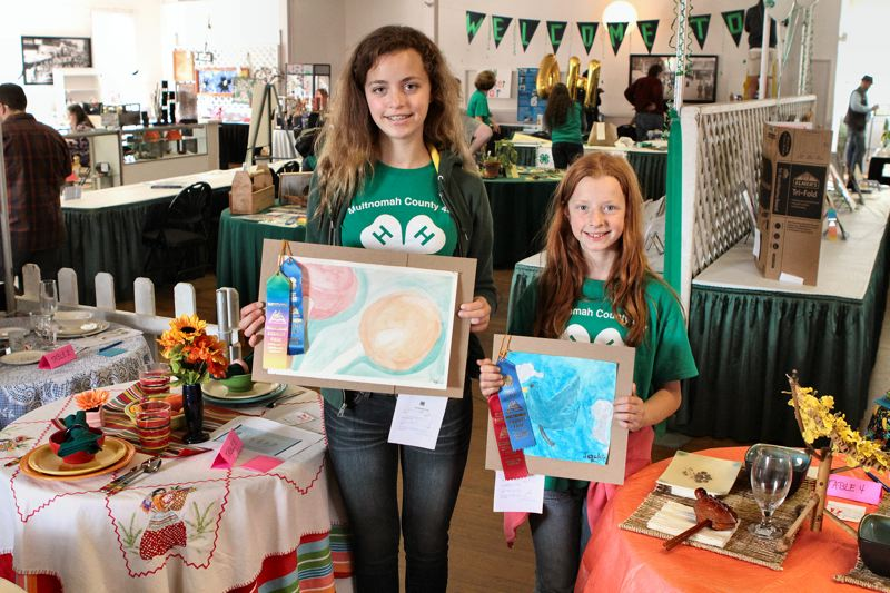 by: DAVID F. ASHTON - These Multnomah 4-H Club members - sisters Julia and Jackie Ruff - show their works of art which won ribbons this year.