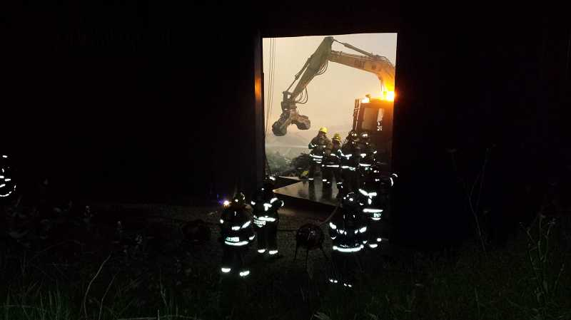 by: COURTESY OF TVF&R - Crews quickly put down a fire that started in a Pride Recycling Company structure Tuesday night.