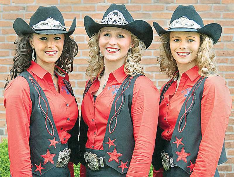 by: ST. PAUL RODEO ASSOCIATION - Royalty - Queen Angie Eichler (center), Whitney Richey (left) and Kristina Bates led the St. Paul Rodeo trail ride last weekend and will continue to represent the Fourth of July spectacle throughout the year.
