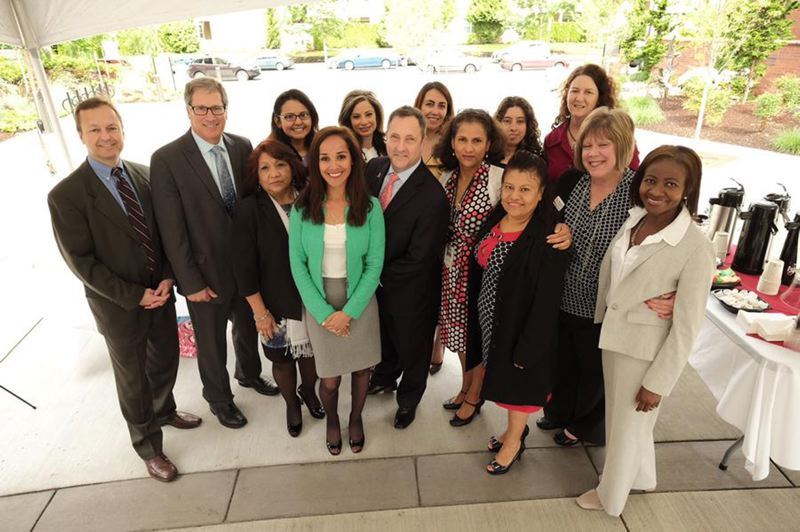 by: COURTESY PHOTO - Representatives of the organizations participating in the Poder y Vida Latina Initiative pose for a group photo May 29 at Kaiser Permanentes new Westside Medical Center after Kaiser Permanente announced it was contributing $1.3 million to the cause.
