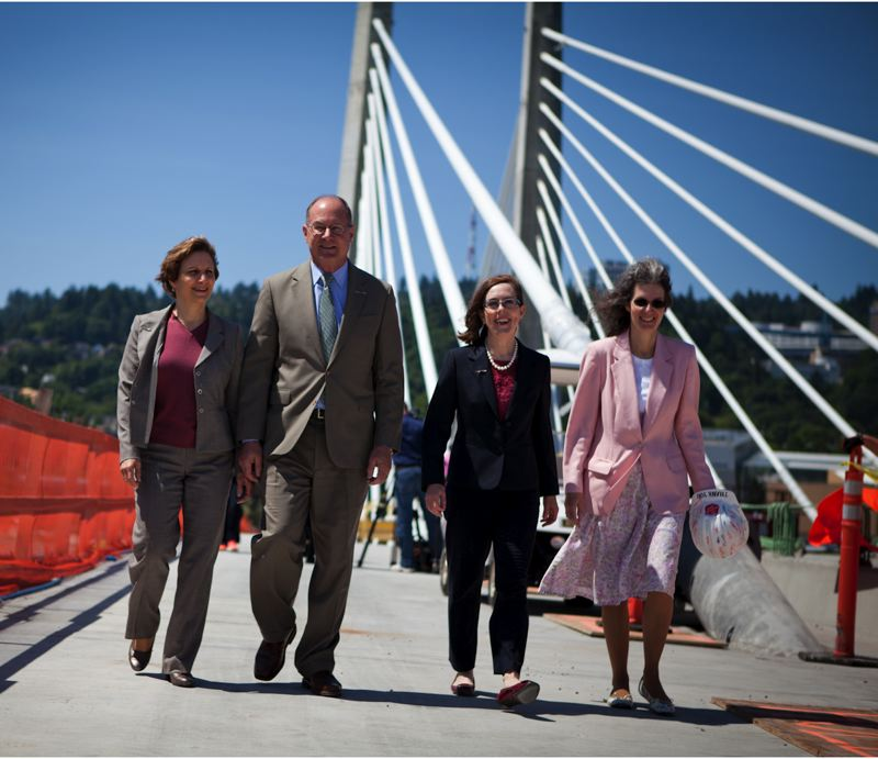 by: TRIBUNE PHOTO BY ADAM WICKHAM - Officials at the Tilikum Crossing ceremony included (from left) Oregon U.S. Congresswoman Suzanne Bonamici, TriMet General Manager Neil McFarlane, Oregon Secretary of State Kate Brown, and Portland City Commissioner Amanda Fritz.