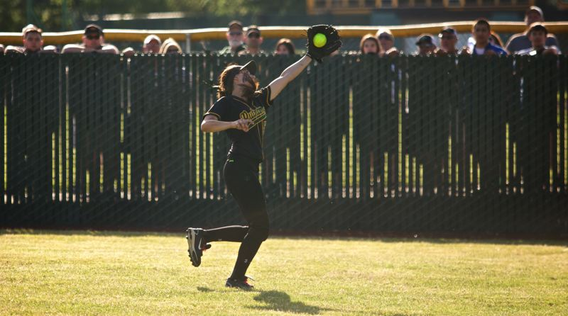 by: JAIME VALDEZ - Senior rightfielder Lauren Roberts makes a game-saving catch in the seventh inning of the semi-final with St. Helens.