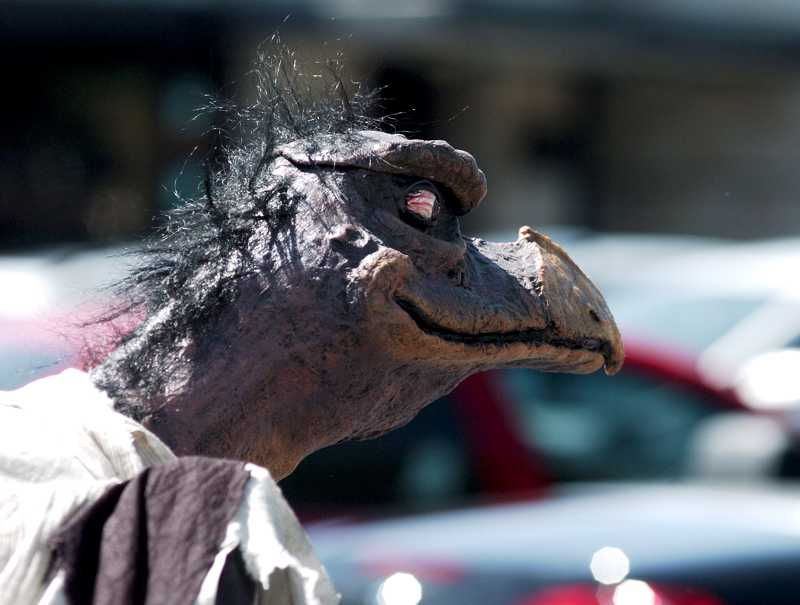 by: TIMES PHOTO: KEITH SHEFFIELD - Part reptile, part predatory bird, a Skeksis, from the early 1980s fantasy film 'Dark Crystal,'' appeared at Uwajimaya's cosplay meet up.