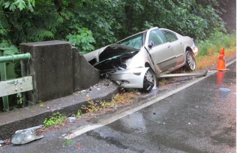 by: CONTRIBUTED PHOTO: OREGON STATE POLICE - Roxanne Wilcox, 25, drove her 2001 Infiniti head-on into the end of this concrete bridge on Highway 224  southeast of Estacada early Friday morning. She is in critical condition at Oregon Health & Science University.