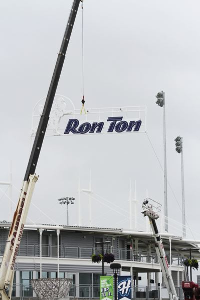 by: HILLSBORO TRIBUNE PHOTO: AMANDA MILES - The new sign at Ron Tonkin field being installed.