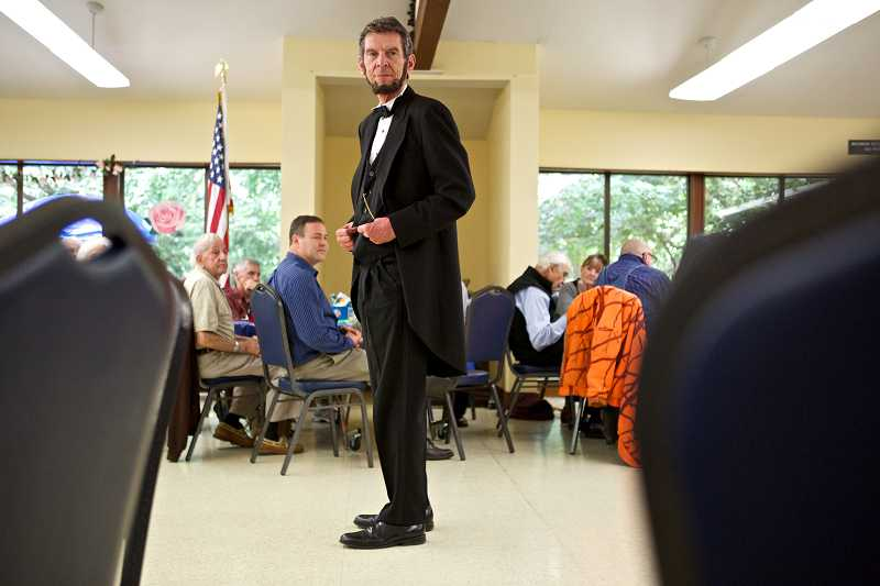 by: TIMES PHOTO: JAIME VALDEZ - Steve Holgate portrays Abraham Lincoln as he entertains seniors at the Sherwood Senior Community Center by reciting speeches Lincoln read in his day.