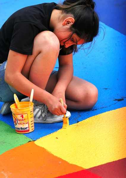 by: OUTLOOK PHOTO: JIM CLARK - Addisun Salazar, 13, of Northeast Portland concentrates on her work while painting on the Plaza del Sol mural.