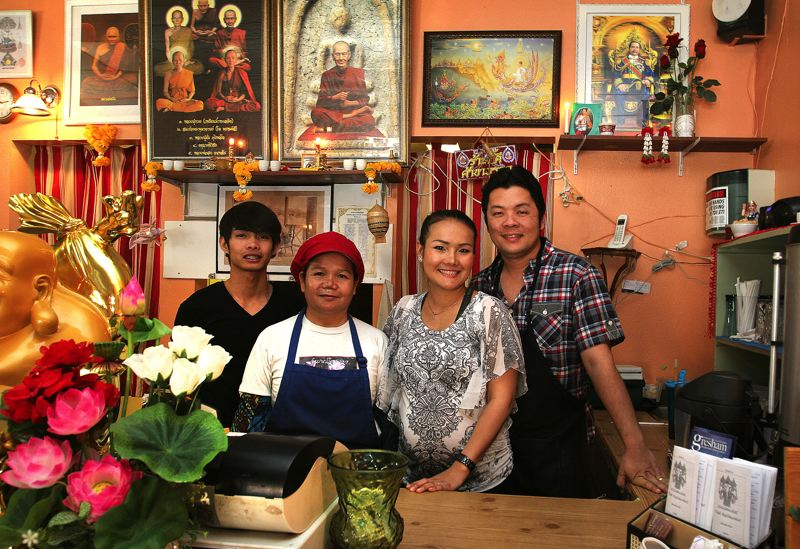 by: OUTLOOK PHOTO: JIM CLARK - Amy Yotngao and her family at Srisiamchai Thai Restaurant in downtown Gresham. From left, cousin Oak Boonsopa, mother Wana Souvannarath, Amy and husband Dean Roadjanahasadin.