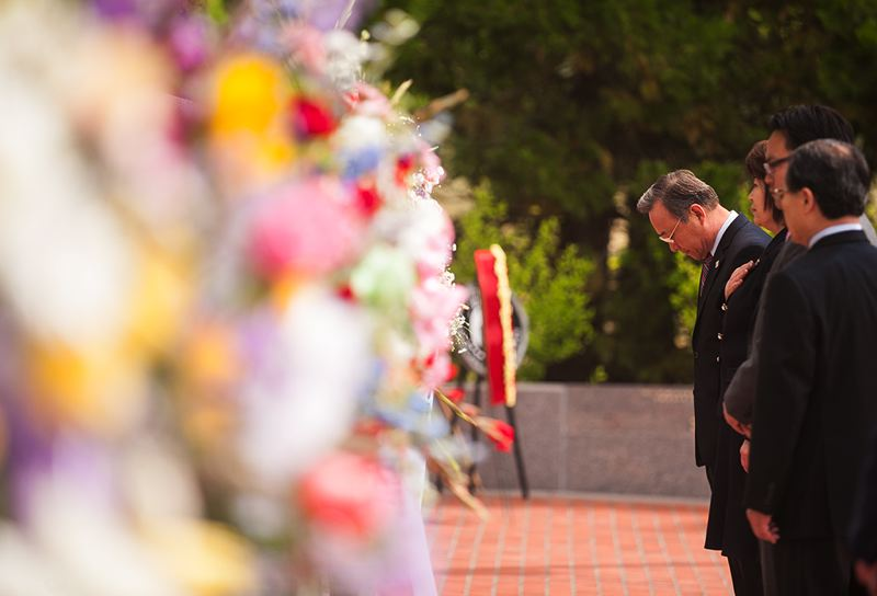 by: SPOKESMAN PHOTO: JOSH KULLA - Members of the Federation of the Northwest Korean Association place a wreath at Wilsonville's Korean War Memorial to honor the hundreds of thousands of Koreans and Americans killed in the fighting.