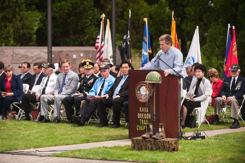 by: SPOKESMAN PHOTO: JOSH KULLA - Wilsonville City Councilor Scott Starr speaks June 21 at a commemoration held at Wilsonville's Korean War Memorial to mark the 1950 start of the Korean War.