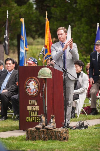 by: SPOKESMAN PHOTO: JOSH KULLA - U.S. Marine Corps veteran and current Director of the Oregon Department of Veterans Affairs Cameron Smith speaks June 21 at a Korean War commemoration in Wilsonville.