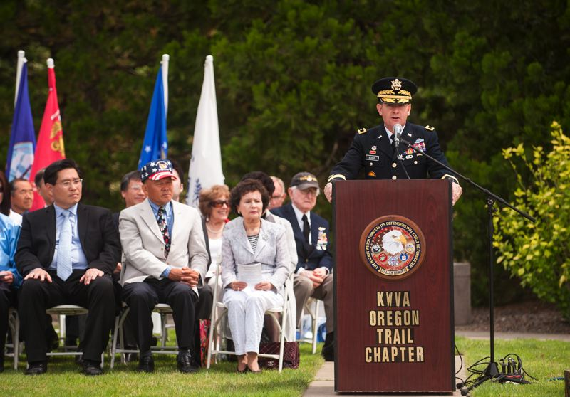 by: SPOKESMAN PHOTO: JOSH KULLA - Brigadier General Steven Beach of the Oregon National Guard speaks June 21 at a commemoration to mark the 1950 beginning of the Korean War.