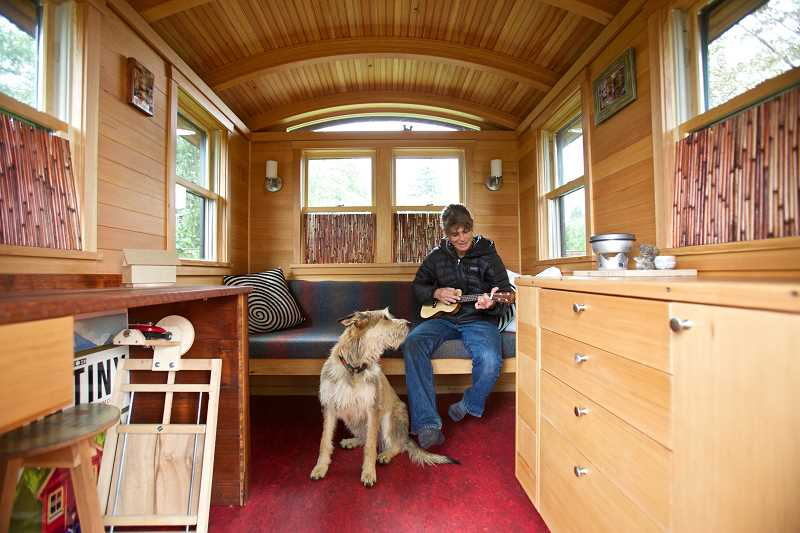 by: PAMPLIN MEDIA GROUP PHOTO: JAIME VALDEZ - Tiny house pioneer Dee Williams doesn't have to play loudly to be heard all around her 54-square-foot  home. Williams says her downsizing to 100 possessions was hampered by a feeling that some of her stuff made her feel like an adult.