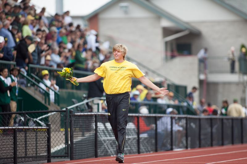 by: COURTESY OF MEG WILLIAMS - Sam Crouser of the Oregon Ducks takes a victory lap at Hayward Field after winning the NCAA javelin title earlier this month.