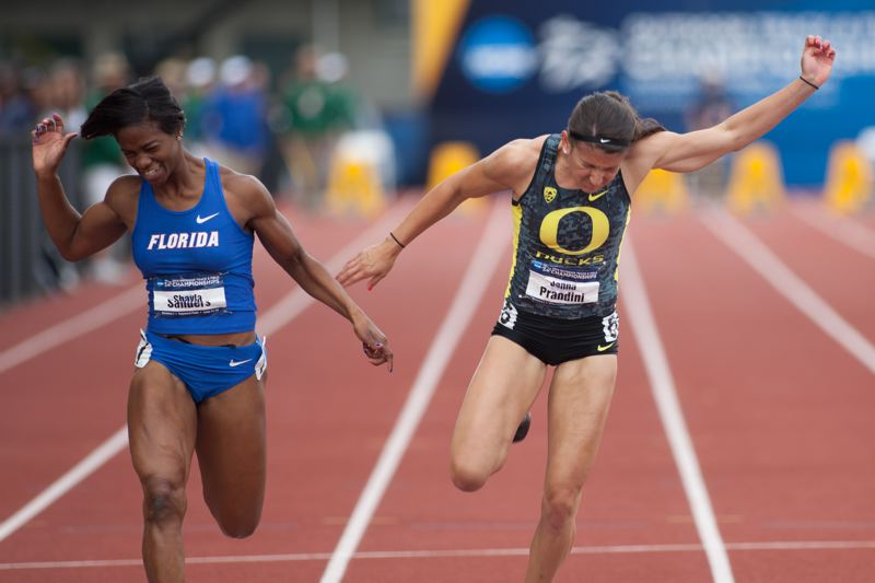 by: COURTESY OF MEG WILLIAMS - Redshirt sophomore Jenna Prandini (right) of the Oregon Ducks won the long jump and finished second and third in the sprints at the recent NCAA championships in Eugene.