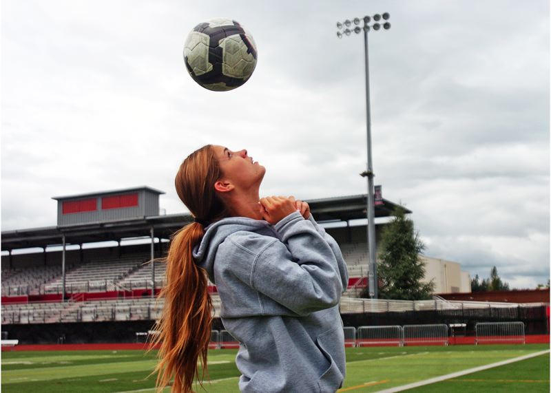 by: DAN BROOD - USING HER HEAD -- Jill Farley capped off her Tualatin High School soccer career with a state championship and long list of honors.