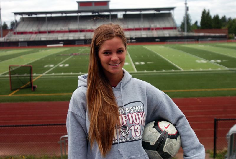 by: DAN BROOD - CHAMPIONSHIP SMILE - Jill Farley, a 2014 Tualatin High School graduate, played many matches at the school's soccer field. Farley will play at Loyola Marymount University this fall.