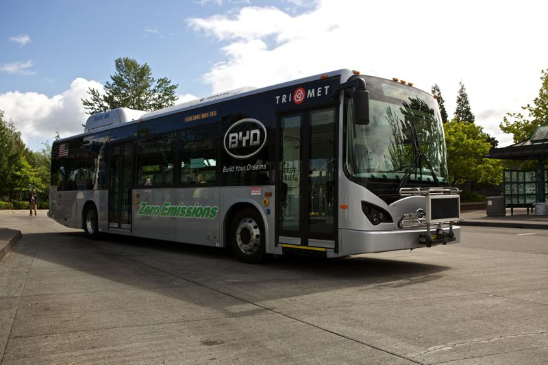 by: TIMES PHOTO: JAIME VALDEZ - Trimet officials debut a test-model electric bus at the Beaverton Transit Center on Friday, June 20.