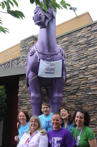 by: HILLSBORO TRIBUNE PHOTO: DOUG BURKHARDT - Volunteers gathered at P.F. Changs bistro at Tanasbourne Monday to promote the Relay For Life event this weekend. Left to right are: Mary Vander Yacht, Kim Knox, Mark Vander Yacht, Steve Atkinson, Pat Salas and Jeanie Zamarripa-Lee. In addition to hosting the volunteers, Changs donated 20 percent of its Monday receipts and painted its iconic horses purple to show support for the American Cancer Societys campaign.