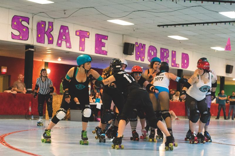 by: HILLSBORO TRIBUNE PHOTO: CHASE ALLGOOD - The Hillsboro-based Air Raid Roller Girls take on Storm City Saturday in their final game of the season.