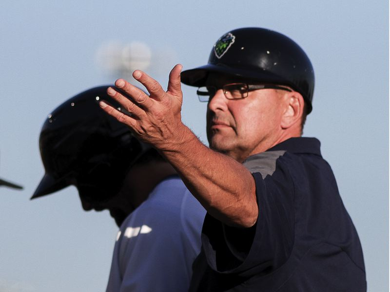 by: HILLSBORO TRIBUNE PHOTO: CHASE ALLGOOD - Hillsboro Hops manager Mark Grace signals into the dugout during last Wednesday's home opener against the Salem-Keizer Volcanoes.