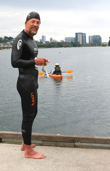 by: OUTLOOK PHOTO: CARI HACHMANN - Dean Hall stands at the edge of the dock at Willamette Park ready to to begin his swim, along with his 79-year-old father in the canoe.