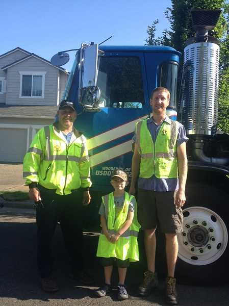 by: KRISTEN FEUZ - Workers at Republic Services, Tony Schlechter (left) and driver Jerry Hettwer helped make Mason DeBruyn's fifth birthday special by giving him a tour of town in a truck and touring the facility on June 23.