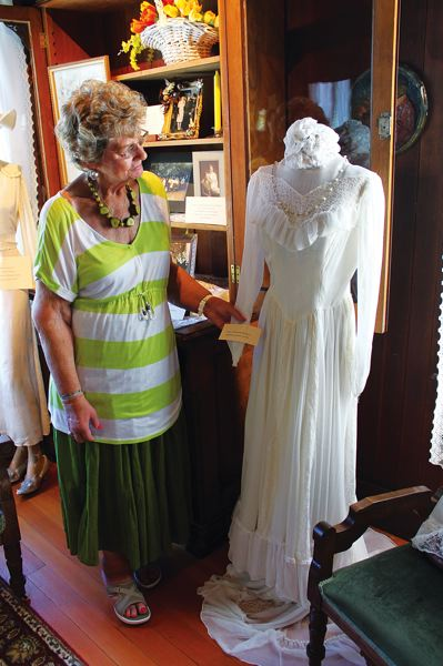 by: OUTLOOK PHOTO: CARI HACHMANN - Troutdale Historical Society member Jean Hybskmann was married to her first husband in this dress in 1951, in Troutdale.