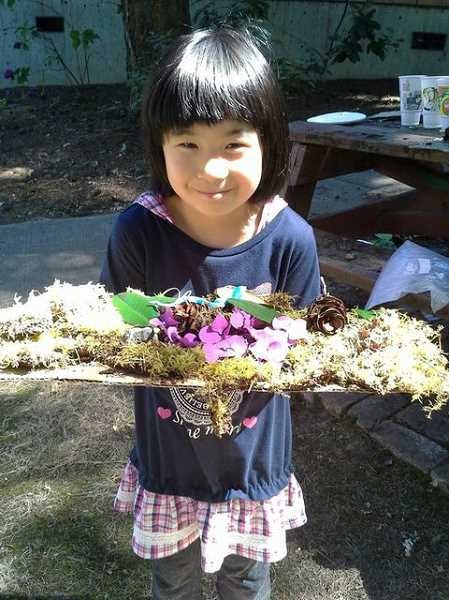 by: SUBMITTED PHOTO - Solupiena Shimosaki creates a nature collage during Camp Kensingtons first year.