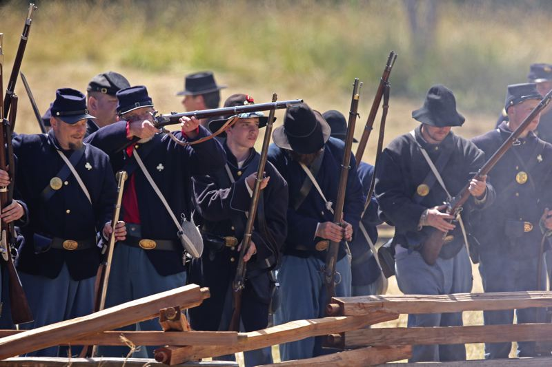 by: SUBMITTED PHOTO: STEPHEN YOUNG - Union soldiers face their Confederate counterparts last weekend at an annual Civil War reeneactment event.