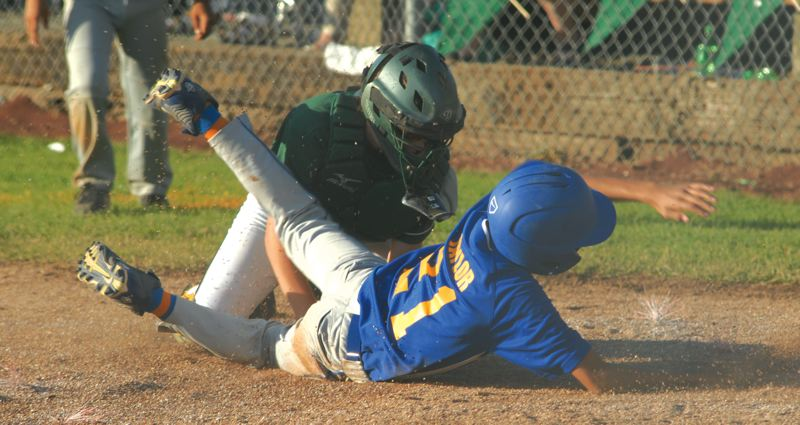 by: THE OUTLOOK: DAVID BALL - Barlows A.J. Taylor slides in under the tag to tie the score in the fifth inning of the teams 5-4 win over Clackamas on Tuesay.