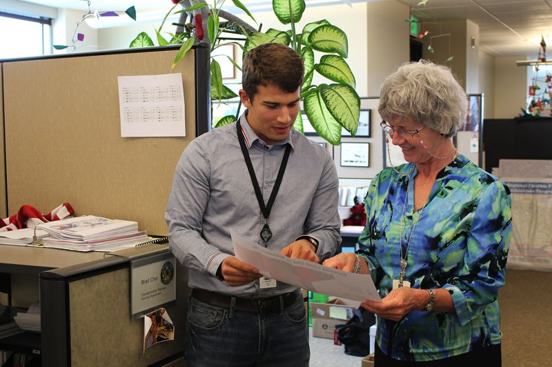 by: COURTESY PHOTO - Intern Jacob Pavlik looks over land use documents with Debbie Raber, project manager for the Hillsboro Planning Department.