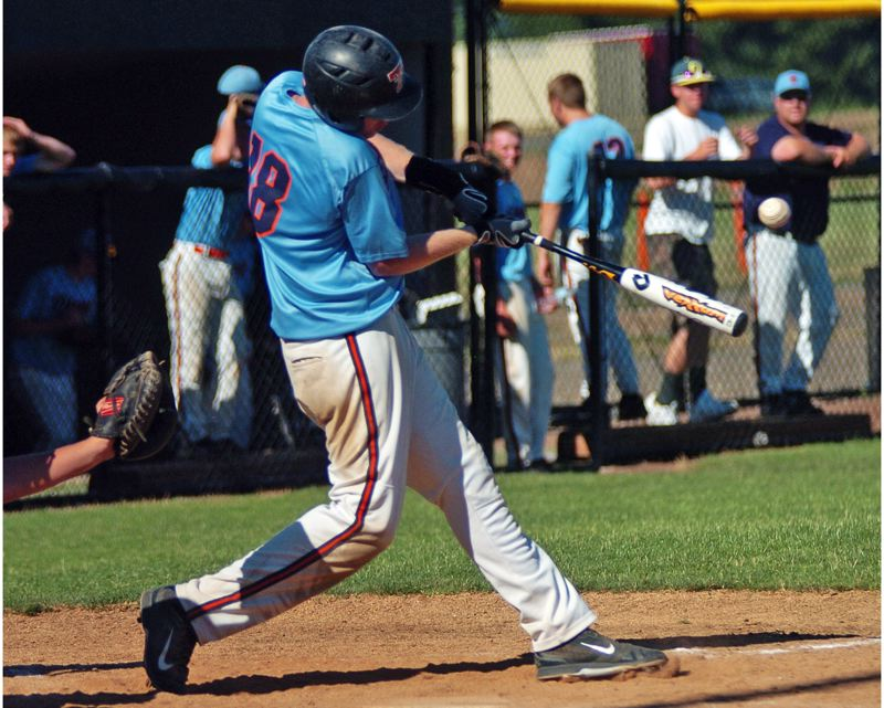 by: DAN BROOD - BIG DAY -- Suburban Door's J.C. Jackson gets his bat on the ball during the first game of Monday's doubleheader. Jackson threw a five-inning no-hitter in the Dawgs' second-game win over Forest Grove.
