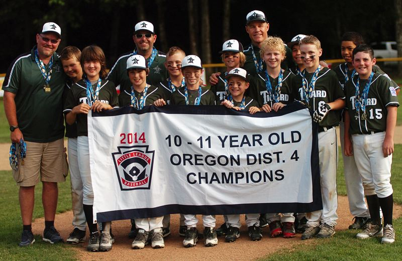 by: DAN BROOD - THE CHAMPS -- The Tigard Little League ages 10-11 all-star baseball team stands with the District 4 championship banner following the squad's 15-5 win over Cedar Mill in Saturday's district tourney title game. Tigard opens state tournament play on Saturday.