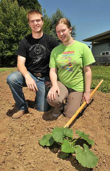 by: PAMPLIN MEDIA GROUP: VERN UYETAKE - Conor McCabe and his sister Caitlin have grown great things, including this pumpkin plant, from the fertile ground outside their parents front door. Proceeds from pumpkin sales each year go straight into the students college education funds.