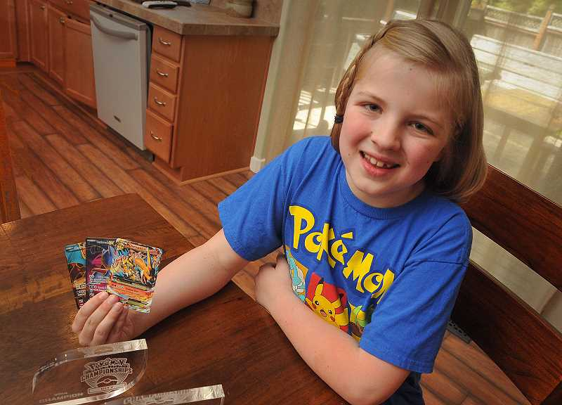 by: TIDINGS PHOTO: VERN UYETAKE - Piper Lepine's interest in colorful Pokemon cards like these has turned into a hobby that involves her whole family and takes her to tournaments around the country.