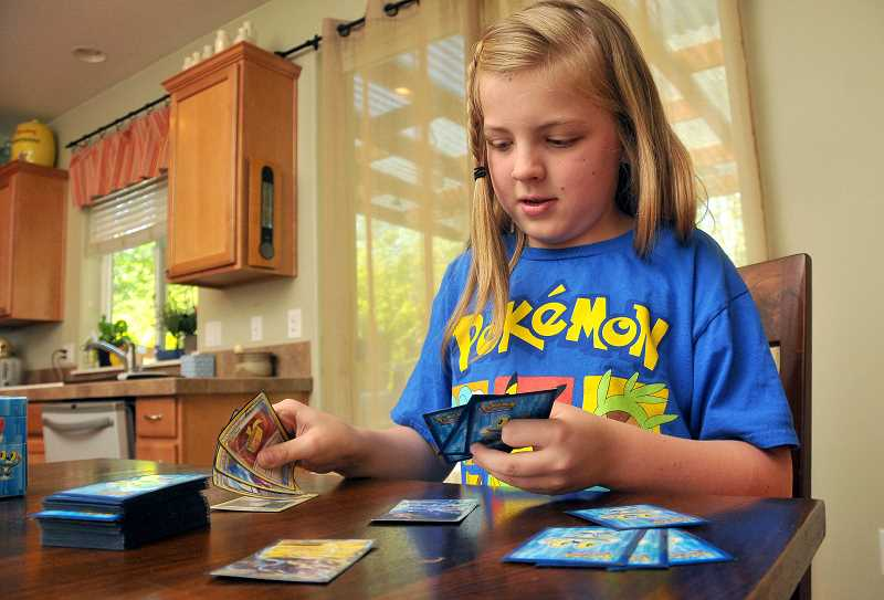 by: TIDINGS PHOTO: VERN UYETAKE - Building a deck of Pokemon cards for tournament play is one of Piper's favorite parts of the game. When she returns to Sunset Primary as a fourth-grader this fall, she will gear up for another season of tournament play.