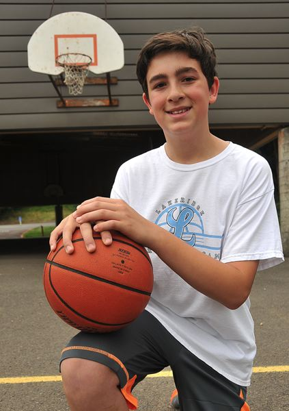 by: VERN UYETAKE - Lake Oswego resident Jake Mount set up a basketball camp for youth players.