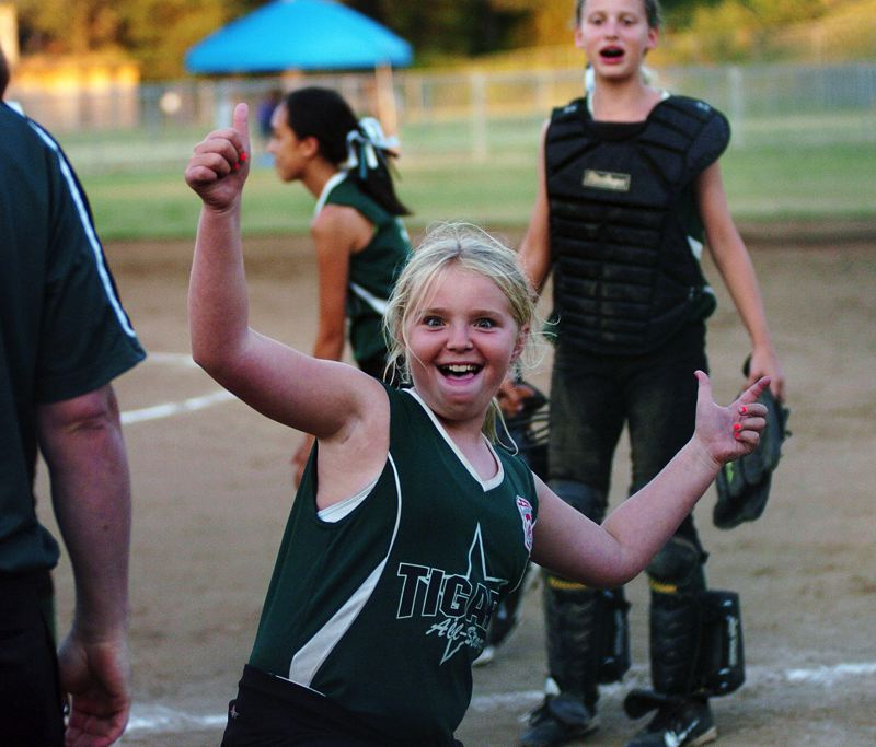 by: DAN BROOD - VICTORY DANCE -- Tigard'' Sophia VanderSommen celebrates following the team's 11-8 win over Centennial in the state title game.