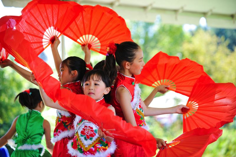 by: TIMES PHOTO: JOHN LARIVIERE - Young members of the Good Time Chinese School dance troupe perform during the Beaverton International Celebration.