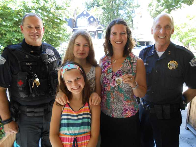 by: REVIEW PHOTO: CLIFF NEWELL - It was a happy occasion for the Freeman family of Lake Oswego when Sunny Freeman was awarded the Chief's Coin on July 16. From left: LOPD Lt. Doug Treat, Anika Freeman (in front), Isabelle Freeman, Sunny Freeman and LOPD Chief Don Johnson.