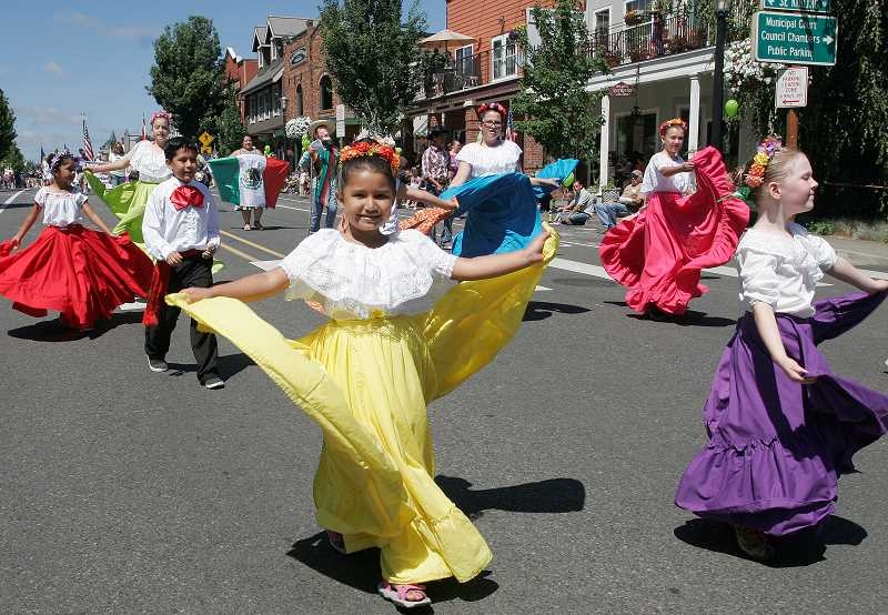 by: OUTLOOK PHOTO: JIM CLARK - Members of the SALT/KAD Performing Arts Center took part in the SummerFest  parade on Saturday.